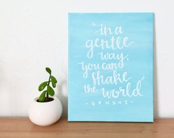 In a gentle way, you can shake the world Gandhi, sign, canvas quote, hand-lettered, blue, inspirational quote, wall art, decor, famous quote