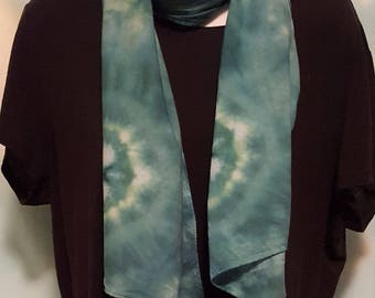 Let there be peace on earth and let it begin with you sporting this lightweight cotton ice dyed tie dye green and blue scarf.