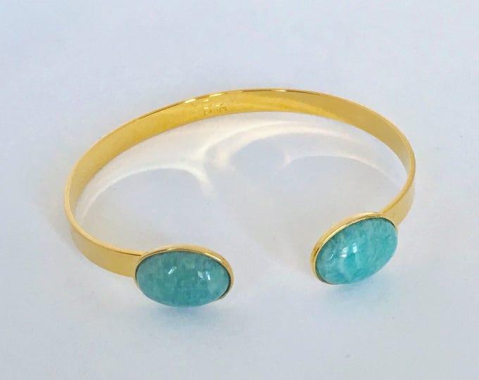 Golden bangle bracelet and Amazon gemstone