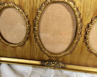 Ornate Gold Tone Frame with 3 slots for pictures.