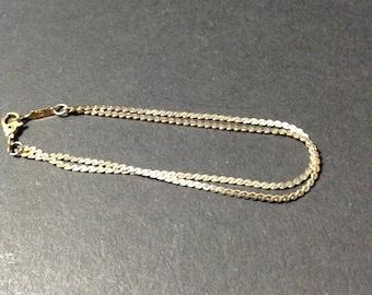 Vintage 2 strand gold tone chain bracelet, signed Monet.