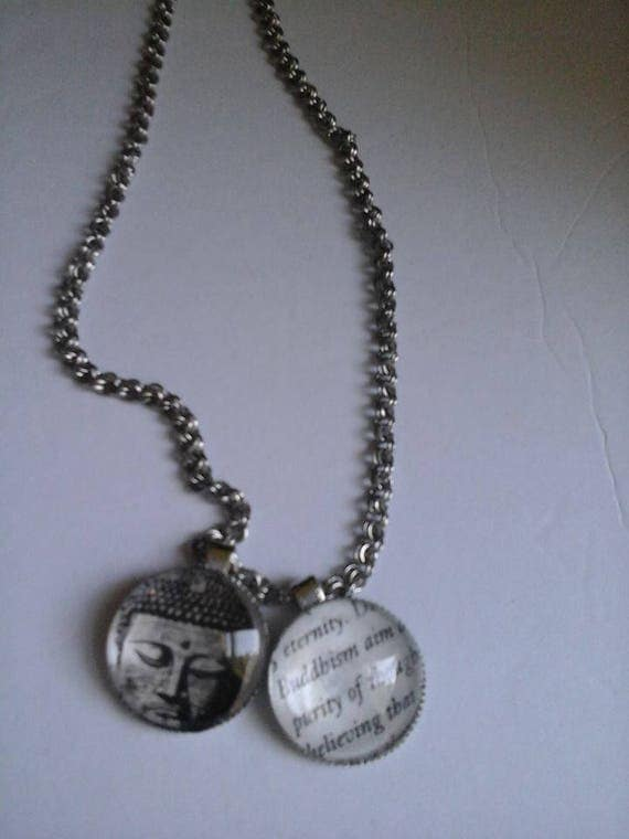 Double Cabochon on Silver Colored Chain Necklace with Buddha Picture and Buddha Script