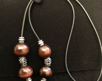 Dark wood and silver beaded Loc tie