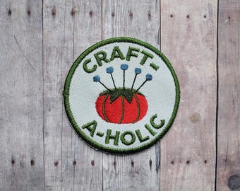 Craft-A-Holic Patch, Crafty Merit Badge, Embroidered White Canvas with Tomato Pin Cushion and Green Text, Choice of Finding, Made in USA