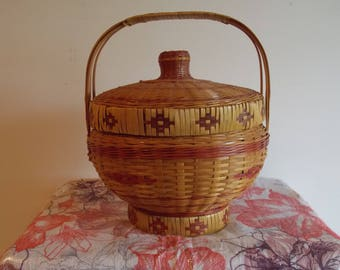 A Chinese / Japanese wicker basket with lid.