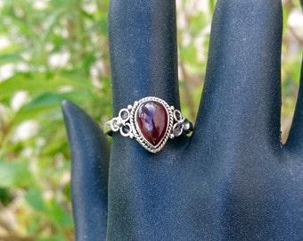 Mounted on silver Garnet ring