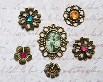 6 pieces of vintage 3D metal stickers. Bronece colors with various gemstones. For scrapbooking or decorating cards.