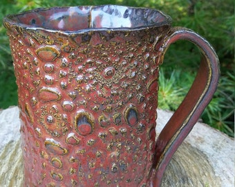 Handmade pottery mug textured with lace and glazed in Ancient Jasper