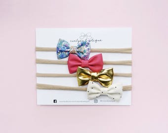 Bright & Girly Newborn Bow Set | Baby headband set, Baby bow Headbands, Small Bows, Baby Bows, Newborn headbands, Nylon Headbands,