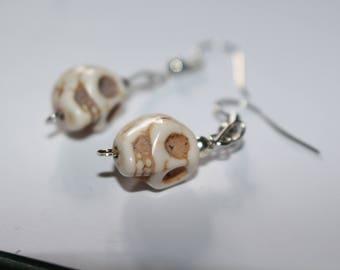 Small white skull earrings