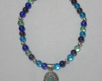 Aqua clear glass beaded necklace with turquoise and silver-plated oval pendant