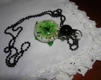 Green turtle lampwork pendant