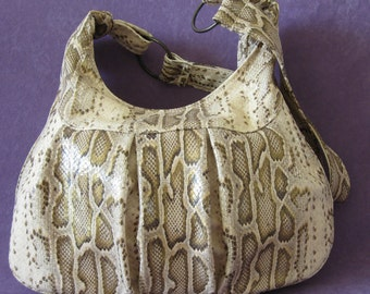 Handbag with a snake print. Genuine Leather.