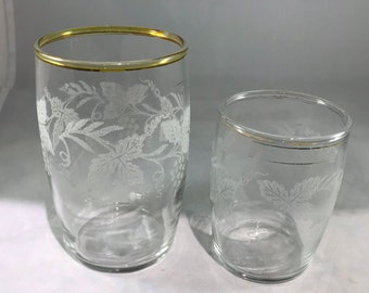 Clear glass with frosted grape vines Juice and a milk glass
