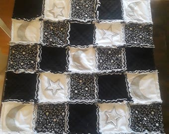 Custom black and white mink fleece and flannel baby rag quilt with embellishments.