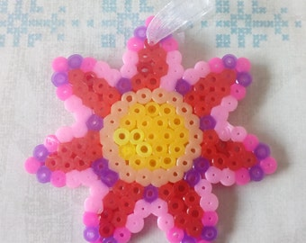 Juju bag or child model in hama beads: colorful flower