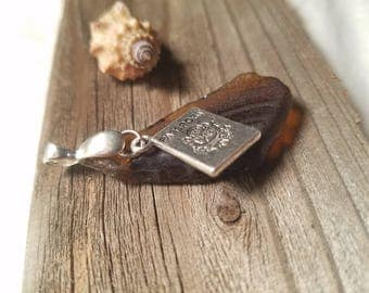 Brown  ridged sea glass pendant w/passport charm