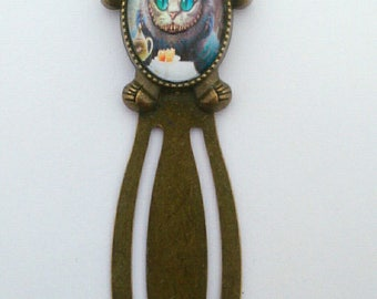 "Bronze paperclip bookmark ""The cat in Alice in Wonderland country""."