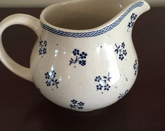 Creamer with toile blue flowers and blue rope along top edge, blue and white  stoneware creamer