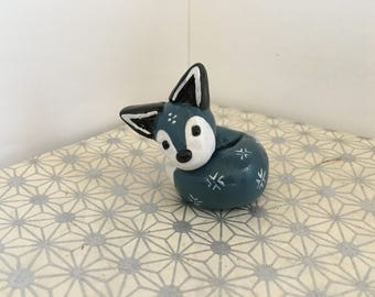 curled snowflake fox clay animal totem