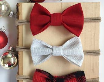 Holiday baby bows, stocking stuffers, christmas baby bows, holiday bows, baby bows, infant bows, nylon headbands, baby girl bows