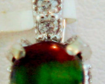 Round Canadian Ammolite and Diamond Pendant set in 14k white Gold.