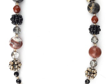 Long necklace with black glossy and satin crystals and four small Portoro marble spheres
