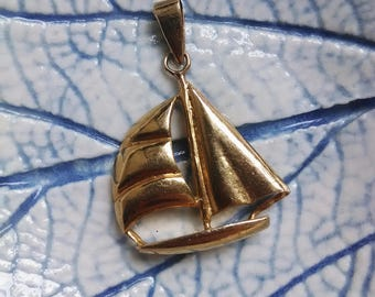 Cute sailing boat golden plated pendant