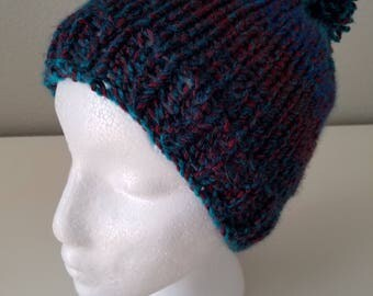 Handmade knitted hats and scarves.