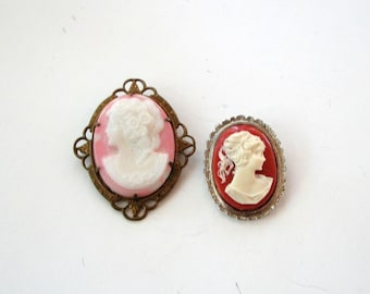 set of 2 vintage cameo brooches . left facing cameo in filigree brass, possibly porcelain or shell