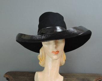 Vintage Hat Adolfo Wide Brim Black Fabric & Shiny Vinyl, 21 inch head, 17 inches wide, 1960s