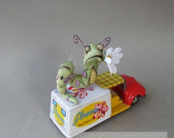 Worm on a Flower Truck Whimsical Ceramic Sculpture