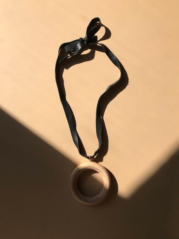 Wood circle pendant on black soft leather
