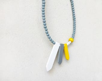 minimalist geometric arrow ribbons necklace in yellow, grey and white , contemporary jewelry