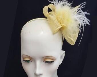 pale lemon yellow sinamay fascinator with feathers on headband fixing ideal weddings races accessory