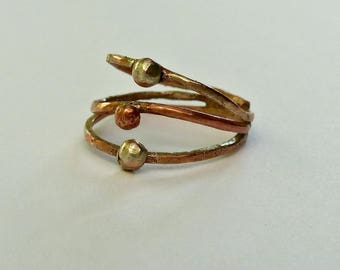 Three rings in copper and silver ring fused clumps.