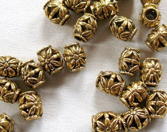 24 Antiqued Gold Alloy Metal Spacer Beads,10mm long x 8mm wide. 4mm diameter hole, 24 pieces
