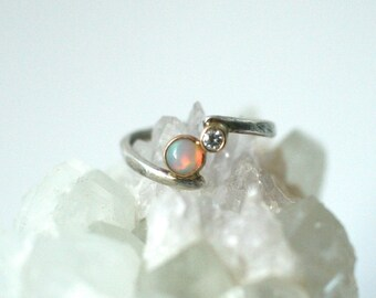 opal and moissanite toi et moi bypass ring, 14k gold and sterling silver twist split band, fire ethiopian opal, vintage style engagement