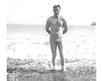 "Vintage Snapshot ""That's Also The Ocean & It's Very Cold"" Shirtless Man Wades In The Water Swim Trunks Found Vernacular Photo"