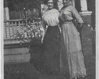 Old photo 2 Women one wearing Long Dress the Other Long Skirt and Polka Dot Shirt Early 1900s Photograph Snapshot vintage