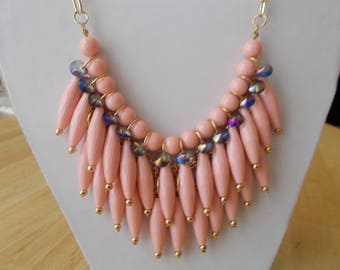 3 Bib Necklace with Light Pink Pendants and Clear Crystal Beads on a Gold Tone Chain