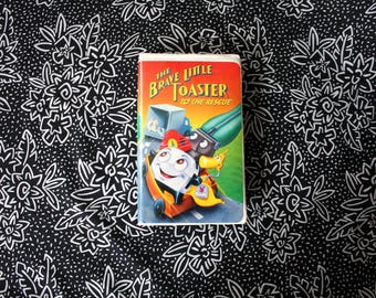 The Brave Little Toaster VHS Tape. Vintage 80s Cartoon Cult Classic. Childrens Fantasy Cartoon 80s VHS Tape. Brave Little Toaster Clamshell