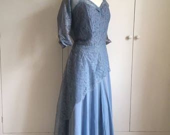 A beautiful floor length sweeping chiffon and lace 1950s light dusky Blue ball gown L/XL