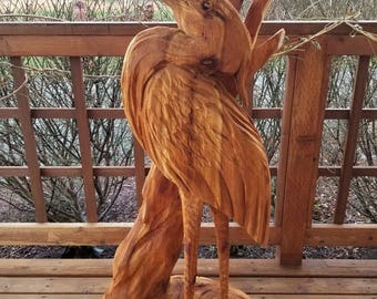 Chainsaw carving of a heron, wood sculpture