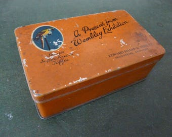 A Present From Wembley Exhibition  (1924-5) – orange Sharps Super Kreem toffee tin with parrot motif by Edward Sharp & Sons, Maidstone Kent