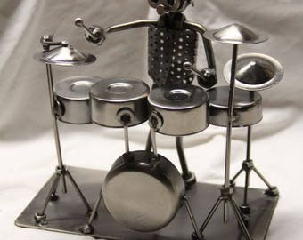 Miniature drummer novelty figurine.  All metal