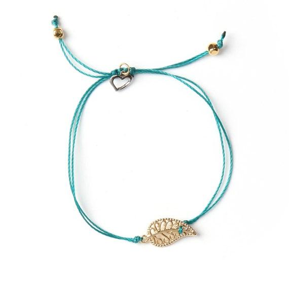 "Delicate gold leaf ""mia"" bracelet on a nylon thread handmade in Montreal"