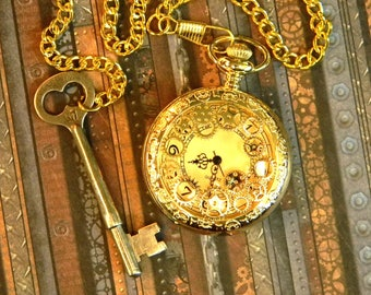 Brilliant Steampunk Inspired Gold Tone Pocket Watch & Chain with Authentic Antique Key Fob.
