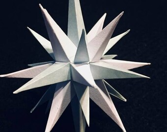 Four inch handmade paper Light Blue and White Moravian Star (Bethlehem Star) used as decoration, ornaments or art.