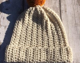Large slouchy pom pom hat